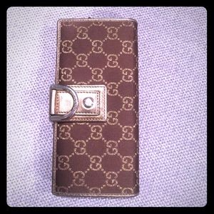 Gucci gold fabric and leather metallic wallet